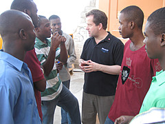 Marc Michault with students in Haiti 2010